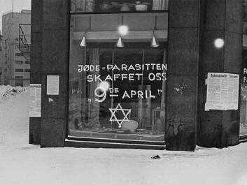 "Anti-Semitic grafitti on store windows in Oslo during the Nazi occupation in 1941. The texts read: ""Jews – the parasite that brought us April 9th"" [the date of the German invasion in 1940] and ""Palestine is calling all Jews. We won't stand for them any longer in Norway!"" (Photo: Anders Beer Wilse (1865–1949)/Wikimedia Commons)"