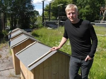 Andreas Treu in front of the lilliput-houses used in experiments with electricity. (Photo: Arnfinn Christensen)