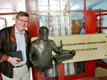 "Ørjan Olsvik, a professor of microbiology at the University of Tromsø, went to Ethiopia to study leprosy. Here Olsvik is standing next to a statue of the  ""father"" of the leprosy bacterium, Gerhard Armauer Hansen, a Bergen doctor who discovered the bacterium in the 1800s. (Photo: Tore Lier)"