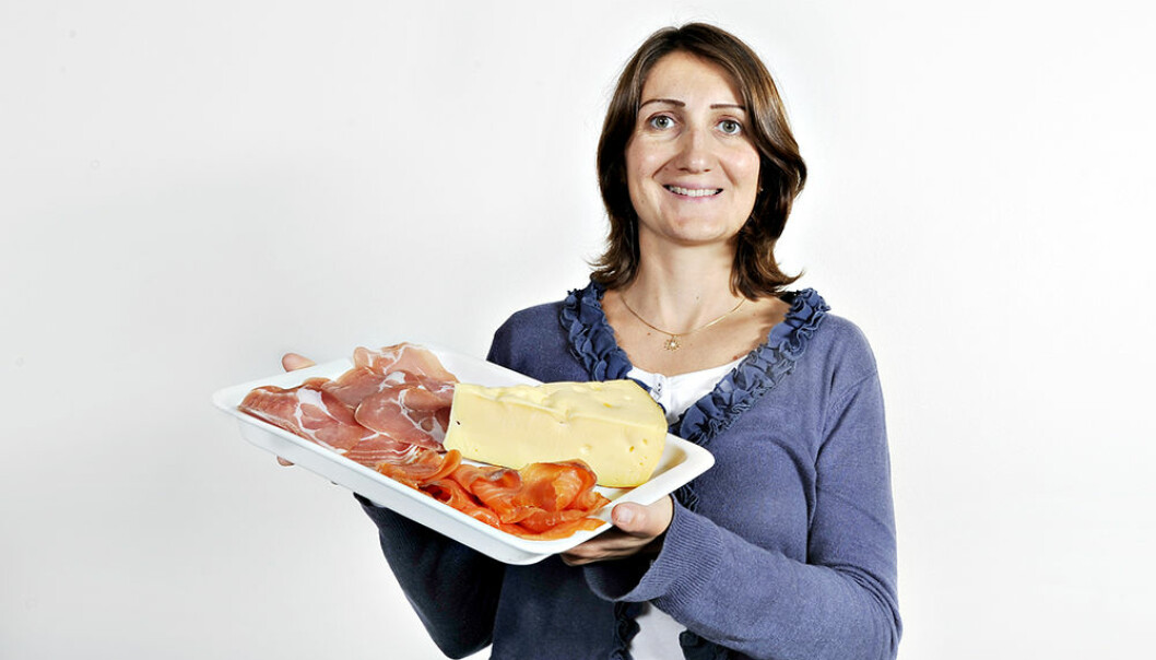 Valérie Lengard Almli studies traditional food, here represented by ham, salmon and cheese. (Photo: Jon-Are Berg-Jacobsen, Nofima)