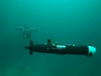 An autonomous underwater vehicle, or AUV, in the foreground. It is a small long-range unmanned sub that can explore large tracts of seabed. In the background is a remotely operated vehicle, or ROV. Working together the two can see quite far and penetrate perilous depths. (Photo: AUR-lab, NTNU)