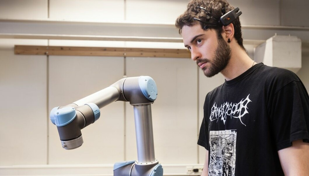 Student Angel Garcia use his eyes, eyebrows and other parts of his face to make the robot move. (Photo: Thor Nielsen)