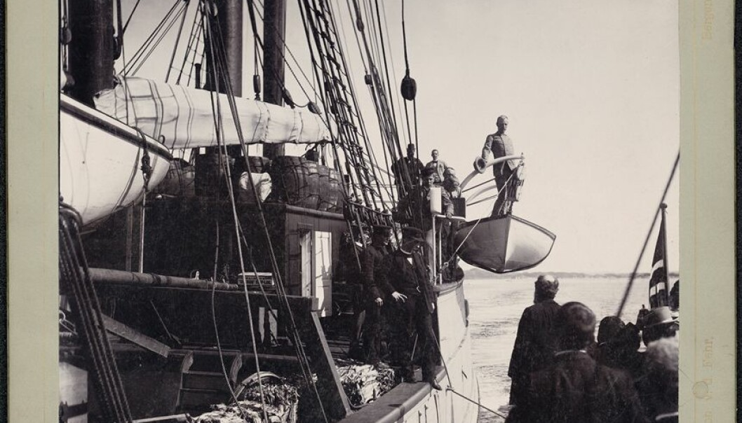 Nansen stands on one of the Fram's lifeboats as the vessel heads north from Bergen, at the beginning of its 3-year-long journey to study the mysteries of the Arctic Ocean. (Photo: Joh v. d. Fehr / from the Norwegian National Library, bldsa_q3c001)