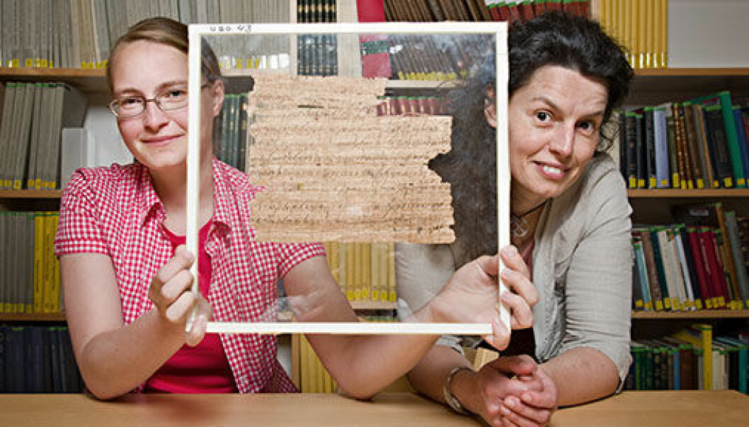 Anastasia Maravela (right), professor of Greek at UiO, heads the team studying the papyruses in the University of Oslo Library. The team also includes Joanne Vera Stolk (left), PhD student, who is here showing us the papyrus fragment that has been found to provide new knowledge on the last poet of antiquity. (Photo: John Hughes)