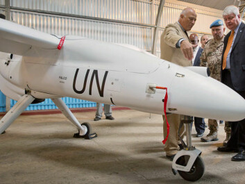 In December the UN started flying its first drones in the Eastern districts of the Democratic Republic of Congo. The head of the UN's peacekeeping operations, Hervé Ladsous, is seen at right inspecting the un-piloted aircraft in the city of Goma. (Photo: Sylvain Liechti, Monusco)