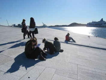 High school students working on a geoscience assignment on the sloping facade of Oslo's Opera and Ballet, which is clad in white granite and Italian marble.  (Photo: Kari Beate Remmen)