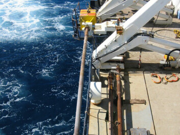 A cylinder for taking core samples of sediments is lifted to the deck of the French Polar Institute's research vessel Marion Dufresne. These cylinders can be 40 metres in length, giving  scientists the ability to analyse the salinity and temperatures of seawater from as long as 128,000 years ago. (Photo: Ulysses S. Ninnemann)