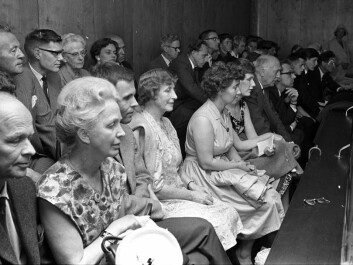 In 1965 the Oslo School Board implemented a nine-year compulsory education scheme. Interest in the capital city's future school system was enormous, as can be seen here in a packed public gallery of an assembly hall, during a school board meeting in June, two months before the new school year started. (Photo: Aftenposten)