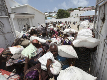 Internally displaced Somali people squeeze through a narrow gate with food relief delivered by the Algerian government for drought victims, in Hodan district, south of Mogadishu, August, 2011. (Photo: Feisal Omar/REUTERS)