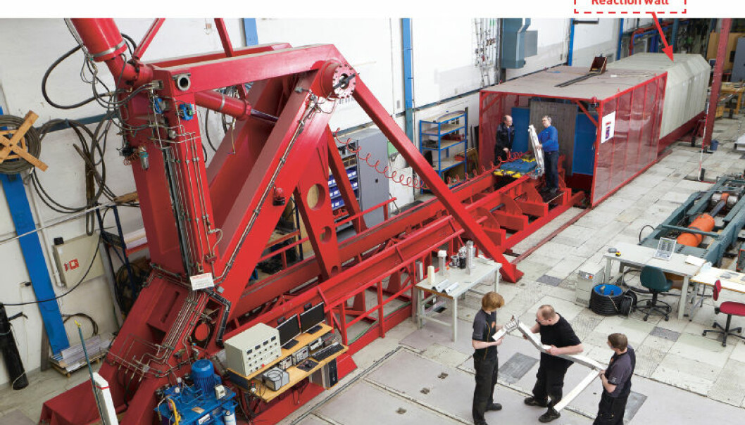 "The two-storey bright red ""Kicking Machine"" is so powerful it needs a 150,000 tonne reaction wall behind it to absorb the force of its blow. (Photo. SIMLab)"