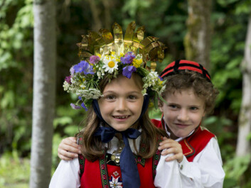 Flower garlands are part of the traditional celebration in both Norway and Sweden. (Photo: Norwegian Museum of Cultural History)