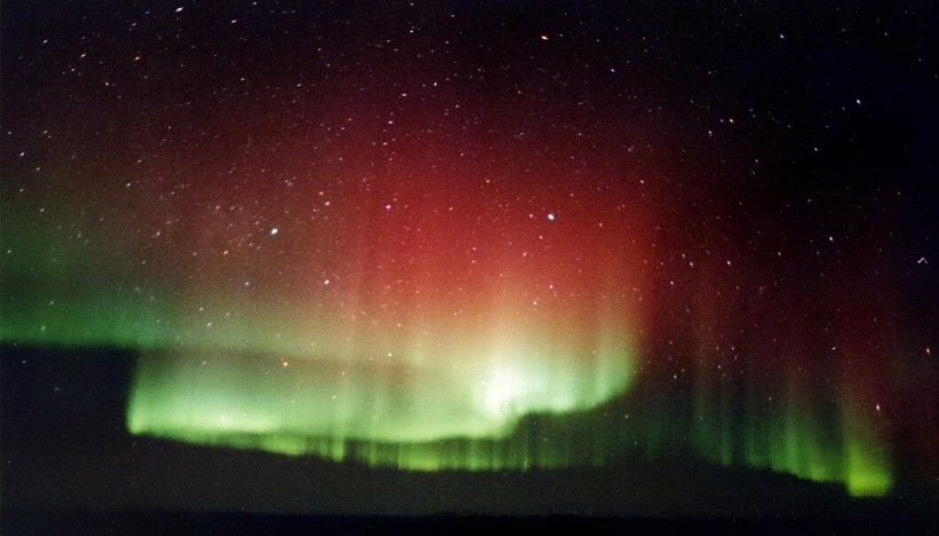 The Aurora Borealis, or Northern Lights, are caused when eruptions from the Sun stream into the Earth's magnetic field and the charged solar particles collide with molecules high in our atmosphere. The reddish light at the top comes from collisions with oxygen atoms high up. The green light, which has a shorter wavelength, is produced closer to the Earth's surface, where the solar electrons have accelerated and slammed into atmospheric particles with greater energy. (Photo: TheBrockenInaGlory, Wikimedia Commons, GNU Free Documentation License)