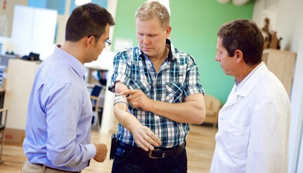 Max Ortiz Catalan (right) and Richard Brånemark with the first patient who received the bone-anchored prosthesis. (Photo: Ortiz-Catalan et al., Sci. Trans. Med., 2014)