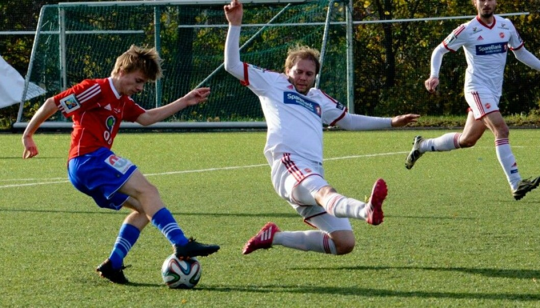 Jens Rongved of the Norwegian soccer team Skeid fakes out a Medkila defender before scoring his team's third goal in this year's last series game.  Skeid won 5–0 at Nordre Åsen in Oslo. Rognved and his teammates now need to make sure they do enough interval training during the winter off-season break. (Photo: Anders Vindegg, Skeid.no)
