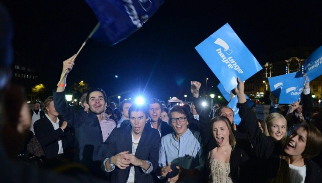 Norwegian youth have grown more politically active in the past few years. But they aren't particularly radical. Here the Norwegian Young Conservatives celebrate outside the national assembly, the Storting, on the election night in 2013. (Photo: NTB scanpix)