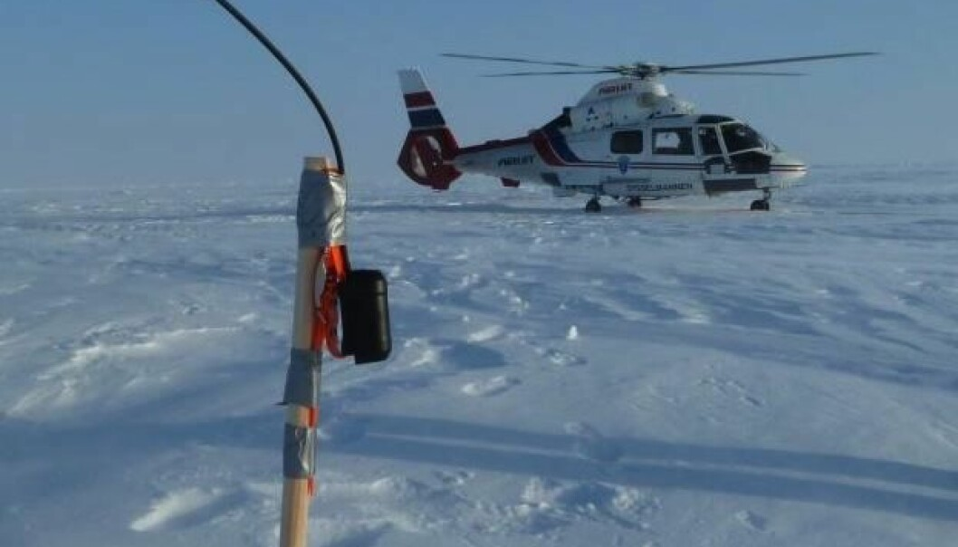 Thickness of the ice was determined by an instrument hanging from the helicopter while flying at low altitudes. These measurements were compared with snow and ice samples and radar images from the satellite, and used to develop an analysis tool for sea ice. (Photo: Sebastian Gerland, Norwegian Polar Institute)