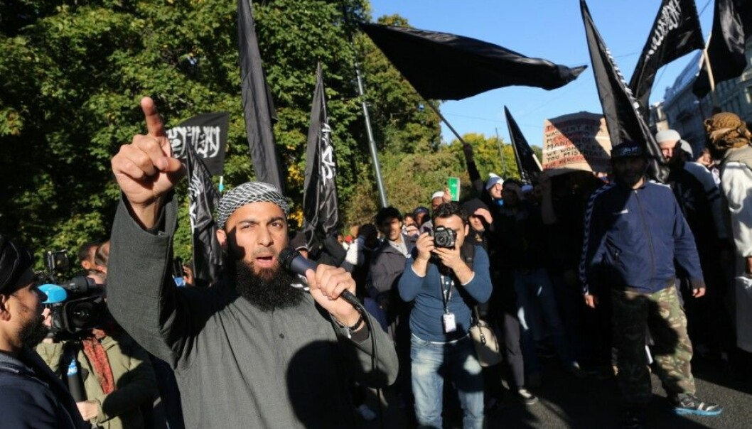 """The Norwegian Ubaydullah Hussain is frequently described in the media as a radical Islamist. His trouble with the law has included being charged for threatening journalists. He is seen here at left, during a demonstration outside the US Embassy in Oslo, protesting the video """"Innocence of Muslims"""" in 2012. (Photo: Kyrre Lien, NTB Scanpix)"""