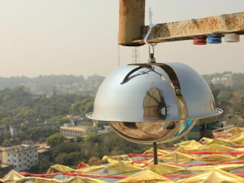 "The image shows air samplers in the city of Chittagong in Bangladesh. The large ""metal dome"" collects air samples for analysis of environmental pollutants, while the three small cylinders measure nitrogen dioxide (blue), sulfur dioxide (red) and ozone (white). (Photo: Scott Randall, NILU)"