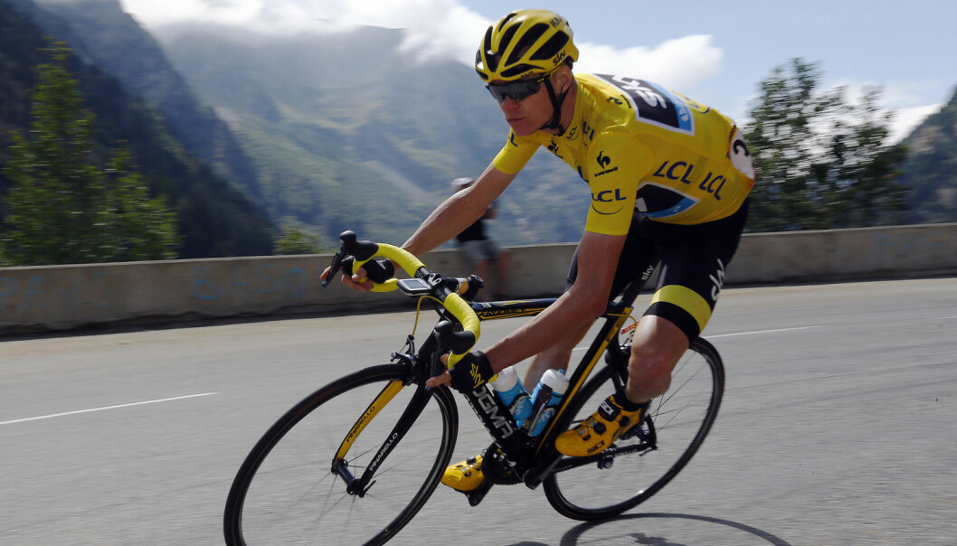 Team Sky rider Chris Froome of Britain wears the race leader's yellow jersey as he speeds downhill during the 110.5-km (68.6 miles) 20th stage of the 102nd Tour de France cycling race from Modane to Alpe d'Huez in the French Alps mountains, France, in this picture taken July 25, 2015. (Photo: Stefano Rellandini, Reuters, NTB scanpix)