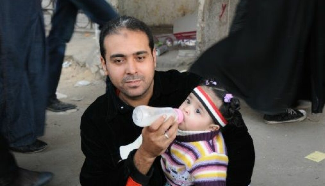 Man with bottle: Nurturing Masculinities. Picture taken by Nefissa Naguib, Cairo 2012