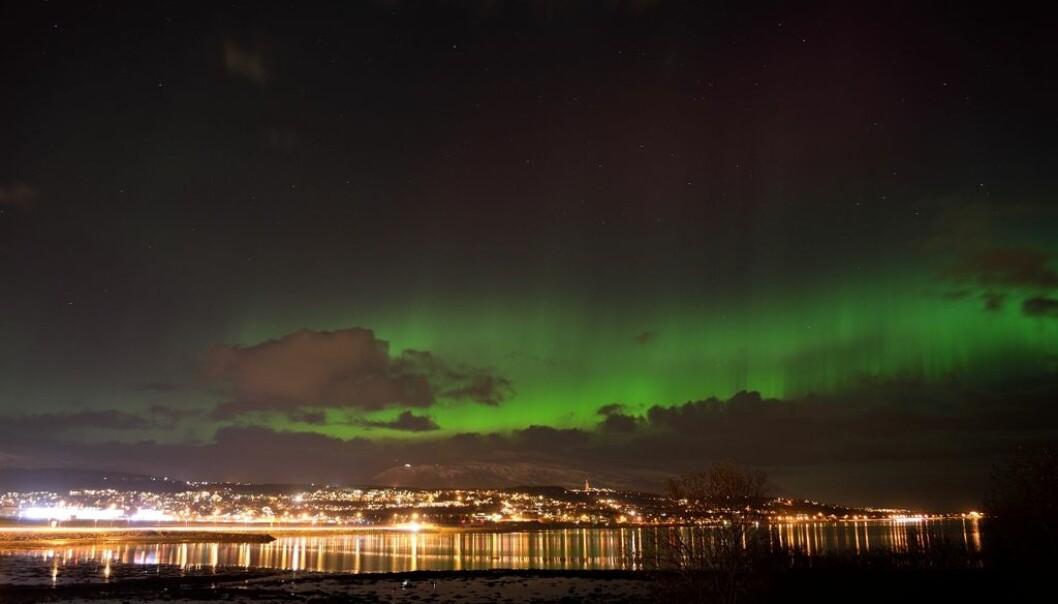 Northern lights over the Norwegian city, Tromsø. (Photo: Colourbox.)