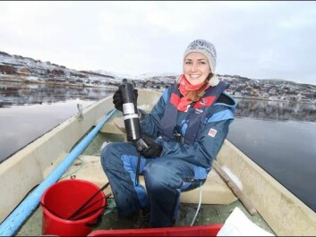 First author Kate Hawley with a telemetry receiver used in the study. (Photo: Guttom Christensen, Akvaplan-NIVA)