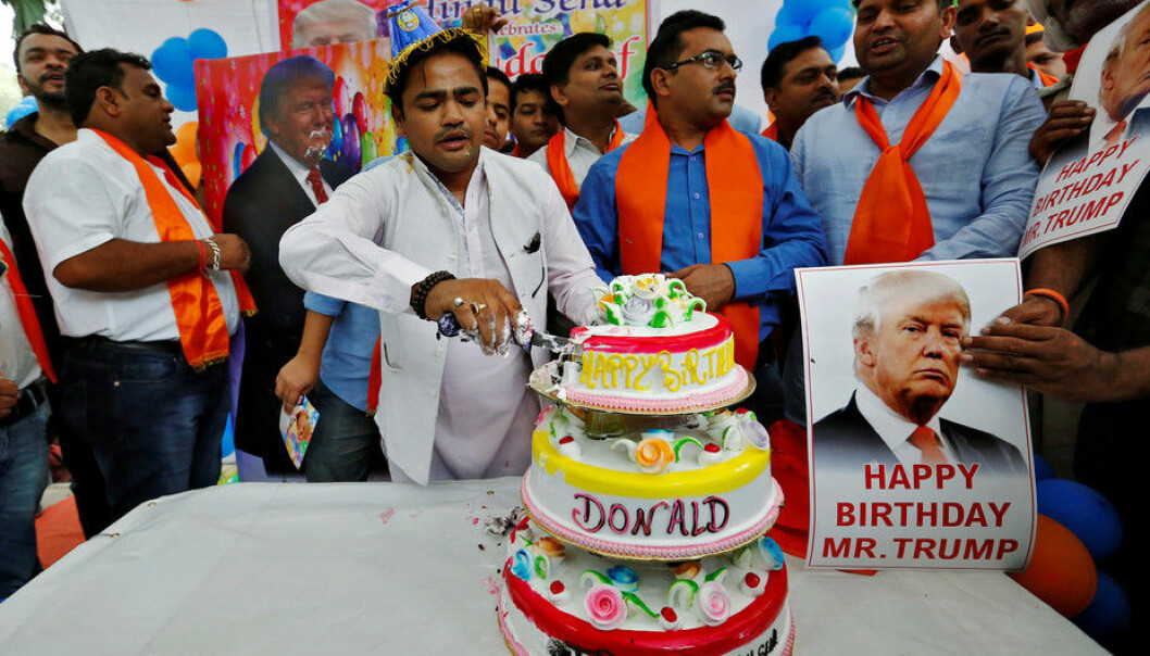 Members of Hindu Sena, a right wing Hindu group, celebrate Donald Trump's birthday June 14, 2016. (Photo: Cathal McNaughton/Reuters)