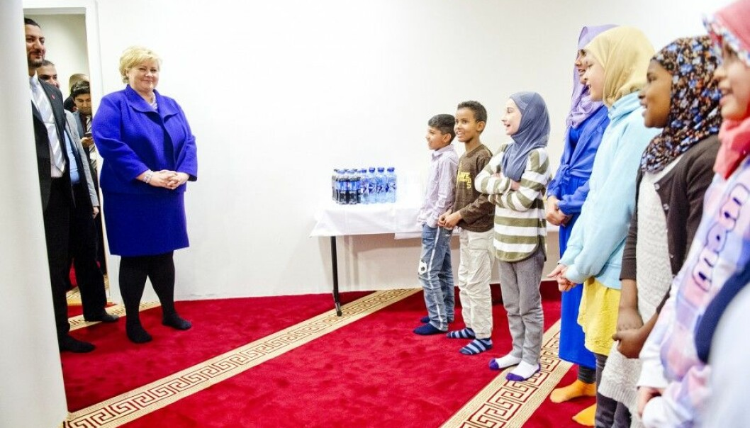 Muslims will probably comprise the youngest group among the major religions in 2050. Here, Norway's Prime Minister Erna Solberg paying a visit to the Islamic Cultural Centre Mosque in Oslo. (Photo: Jon Olav Nesvold/NTB scanpix)