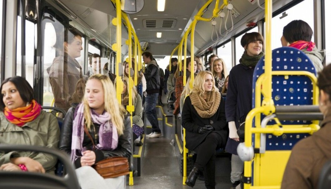 Norwegians don't care to start conversations with strangers on the bus. They strive to find a seat where they can sit by themselves. But does that mean that they are impolite? (Photo: Shutterstock / NTB Scanpix)
