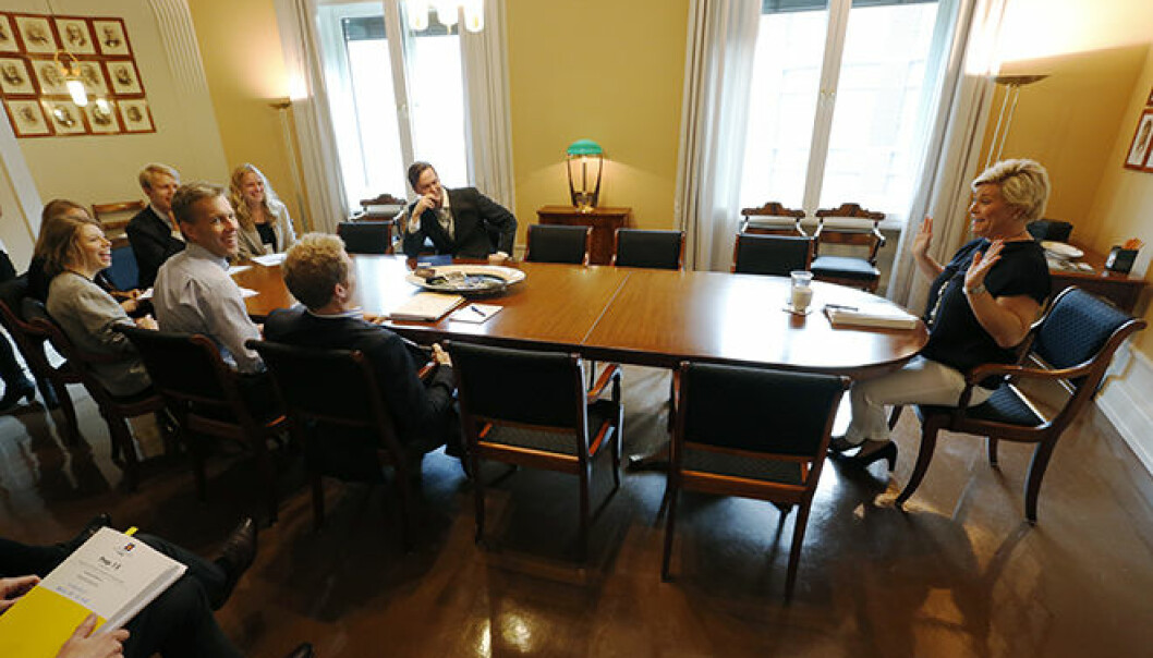 Economists are powerful in the Norwegian Ministry of Finance, according to Johan Christensen. Pictured: Minister of Finance Siv Jensen and bureaucrats in the Ministry preparing a presentation of the National Budget, 6 October 2014. (Photo: Lise Åserud / NTB Scanpix)