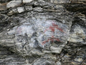 The male figure was painted with a mixture of ochre and fat. (Photo: UiT The Arctic University of Norway)