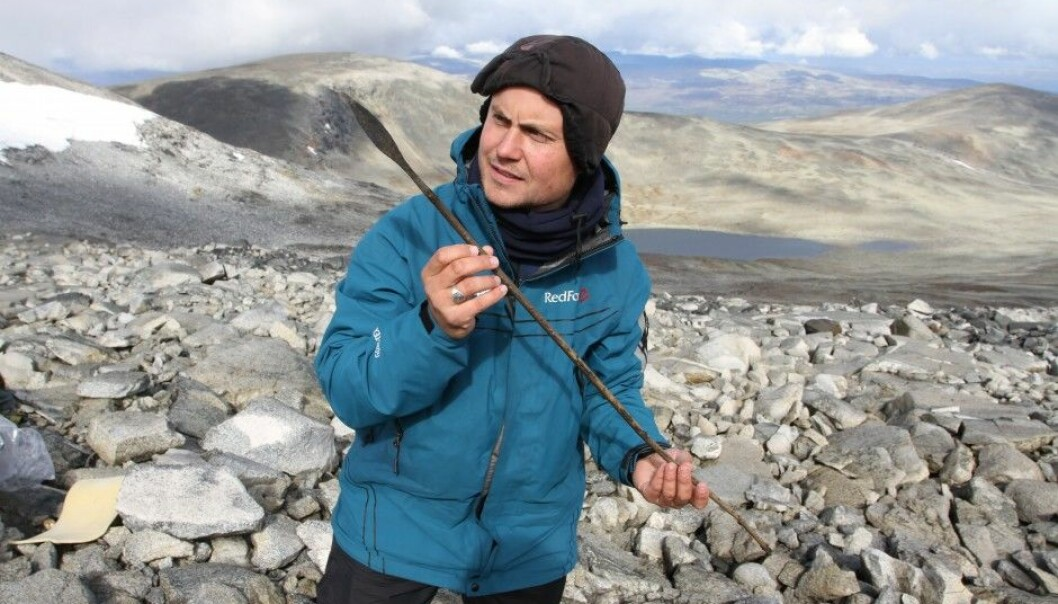 An archaeologist holds up an arrow, circa 1,400 years old, which was lost in a reindeer hunt in the mountains of Norway's Oppland County during the Late Antique Little Ice Age. (Photo: Julian Martinsen, secretsoftheice.com/Oppland County)