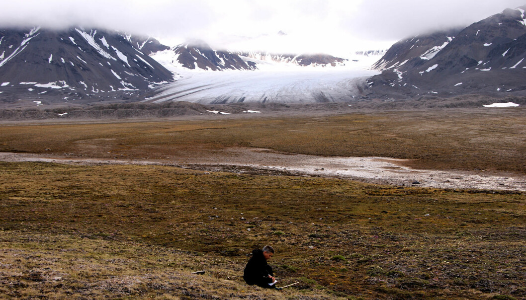"""Warmer winters on Svalbard are not tantamount to a greener landscape"", says researcher by Jarle W. Bjerke. The image shows Bjerke doing fieldwork on Svalbard. (Photo: Trond Pedersen)"