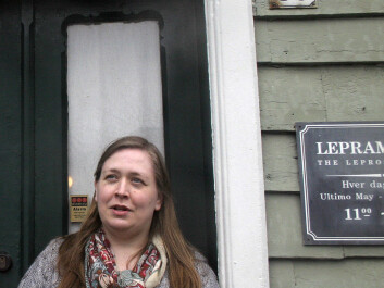 Historian Grete Eilertsen in front of the Leprosy Museum. (Reprinted courtesy of the Leprosy Museum St. Jørgens Hospital/ the Bergen City Museum)