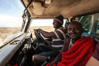 Onesmo, left, a driver and field technician on the African wild dog project, and a Maasi man out on the job. (Photo: Per Harald Olsen, NTNU)