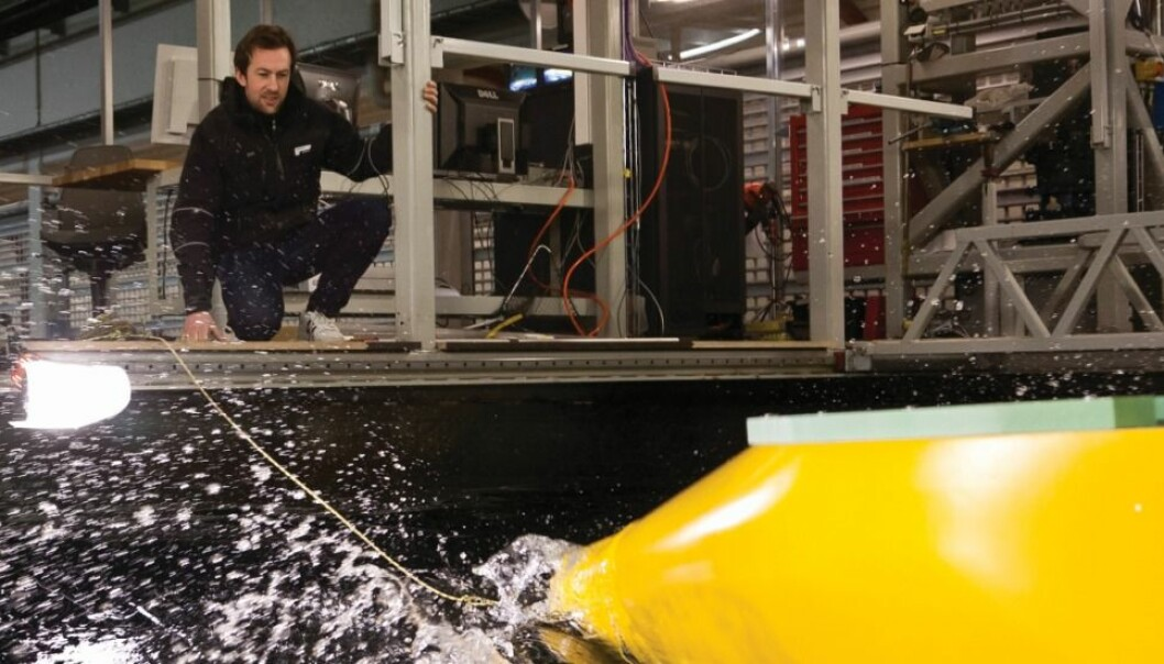 Toralf Hamstad tests a new hull in the ship model tank at SINTEF in Trondheim, Norway. (Photo: Thor Nielsen)