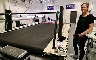 Guro Strøm Solli next to the giant treadmill where Bjørgen and other elite skiers are sometimes tested. The size of the treadmill allows the skiers to use roller skis while researchers measure different vital signs. (Photo: Nancy Bazilchuk / NTNU)