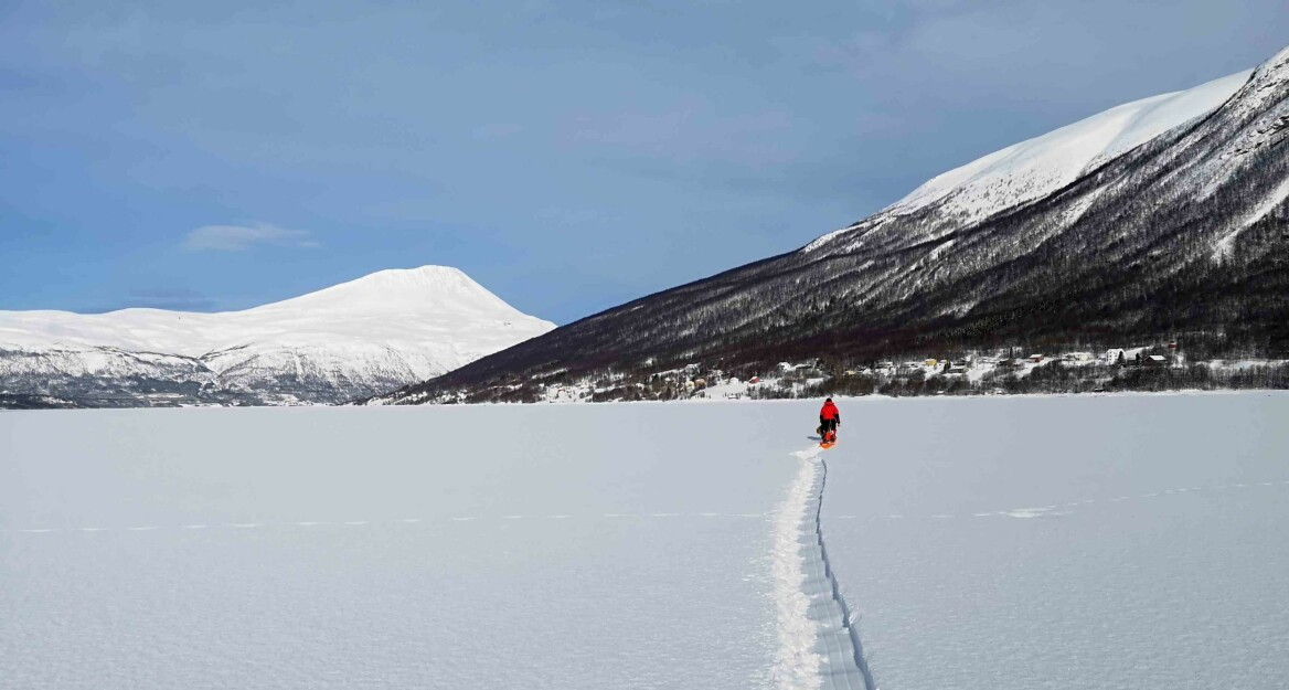 To gather samples, the author and an assistant pull sleds holding various equipment out to the center of the fjord. Shown here, a day out on the ice in Ramfjord located outside of Tromsø, Norway. (Photo: Private)