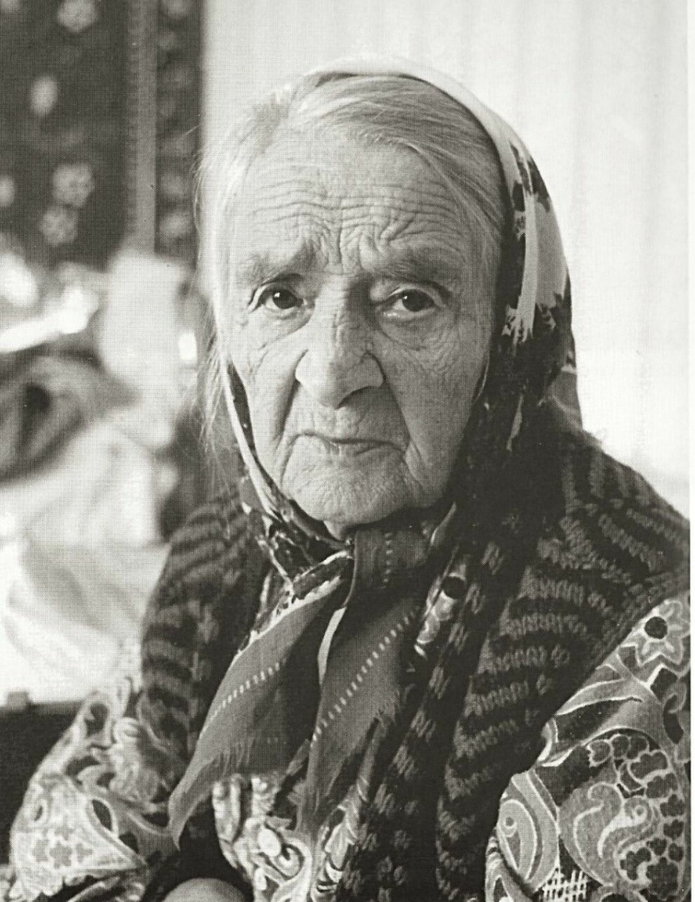 """Nelly Berger lost a little boy in Tarza, but managed to save the lives of her other three children. In addition, she took care of a foster child. When Morten Jentoft met her in Karelia, she had hardly spoken Norwegian with anyone in 50 years. Still, she remembered the language well: """"I speak to myself and then I have an old hymn book from my mother,"""" she told him just weeks before her death in 1993."""