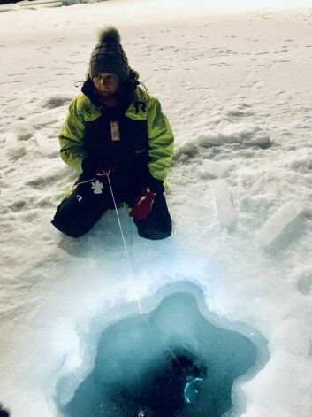 Sampling water through a hole in the ice.  The ice thickness here at 82°N is 120 cm and below  this ice there are 3800 meters with dark cold sea water, that contains a substantive diversity of cold loving organisms.