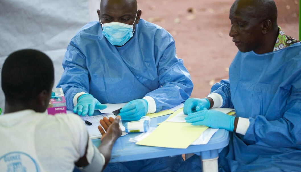 WHO health personnel treat a patient during the Ebola outbreak in Guinea. As WHO increasingly works locally, it is important to incorporate cultural contexts in clinical guidelines and policy.