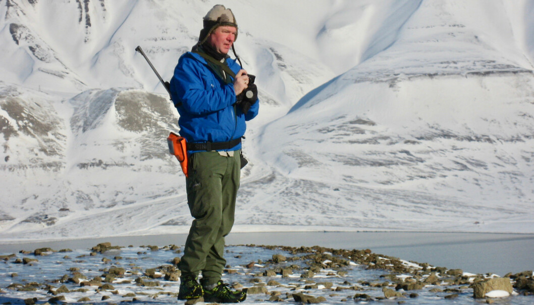 Bjørn Munro Jenssen out in the field in Svalbard. Like all field researchers on the Norwegian archipelago, he has to carry a rifle and a flare gun because of the risk of polar bear attack.