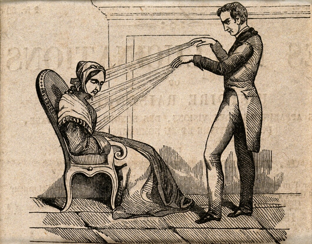 A woman getting a good dose of animal magnetism treatment. Or not. Blind tests showed that patients reacted when they believed the therapist was directing the mystical magnetic energy toward them, even when none of this hocus pocus was being conducted.