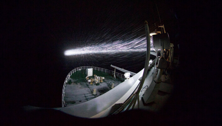 Just how dark is dark? The lights from the research ship illuminate blowing snow, but outside of that, the area looks dark — to human eyes, anyway, but not to creatures that are adapted to the polar night.