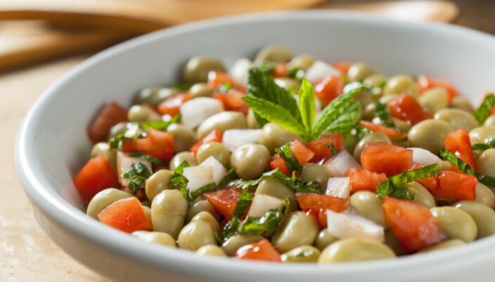 A salad with fava beans, tomatoes, onions and mint.