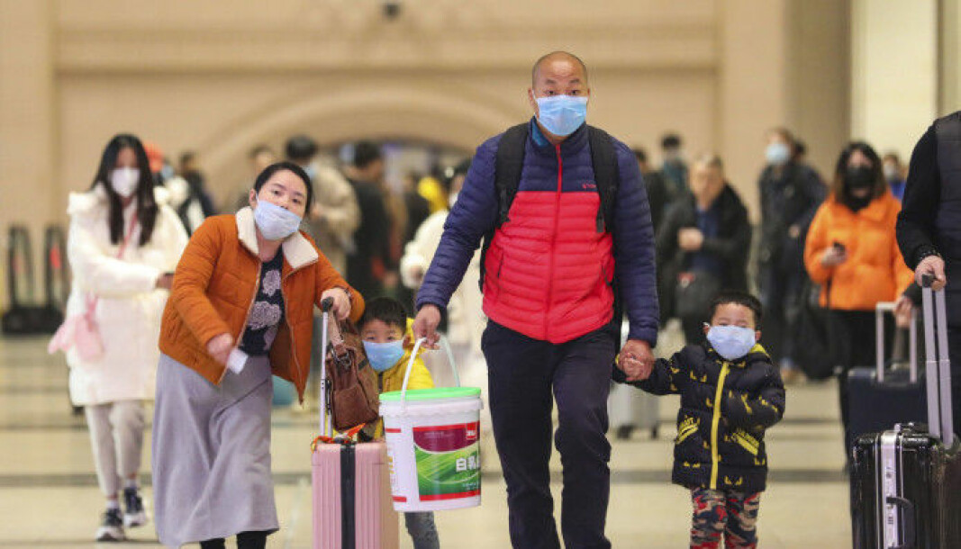 A chinese family with face masks at the train station Hankou in Wuhan 21 January 2020.