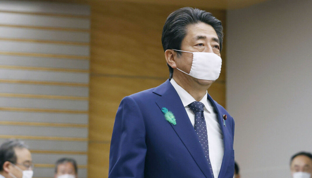 Japanese prime minister Shinzo Abe wearing a face mask. Using face masks in Japan and China started with the Spanish flu, but continued after the outbreak was over.