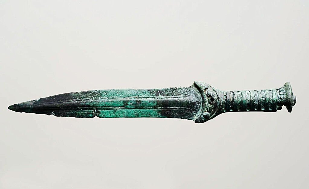 A bronze dagger from the older Bronze Age. It was found during the excavation of a gravel pit at Inderøy in northern Trøndelag County.