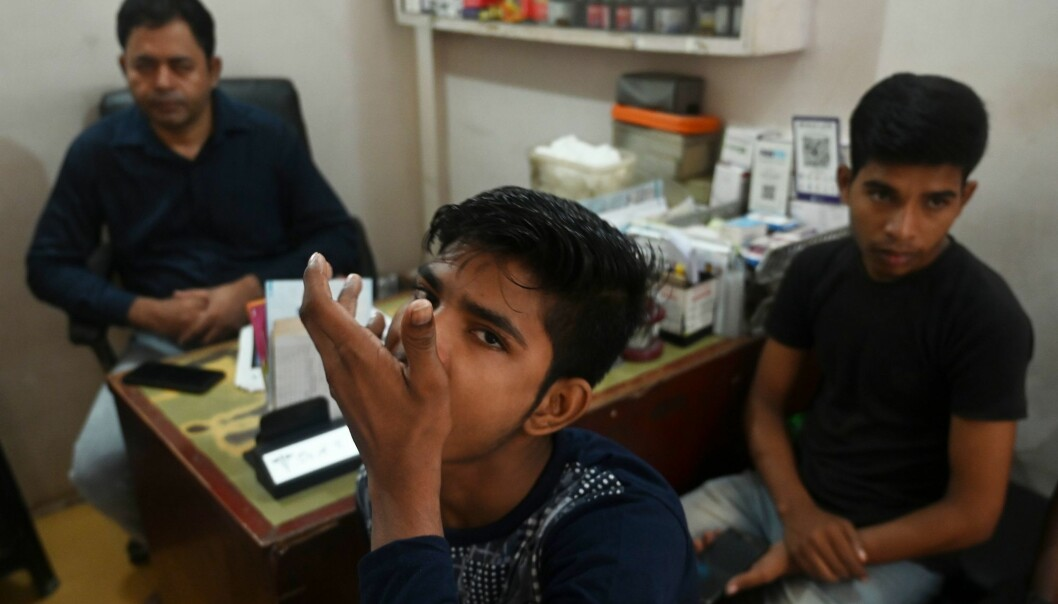 In this photograph taken on September 26, 2019, a tuberculosis patient takes his daily dose of medicine at a DOTS (directly observed treatment, short-course) Centre in New Delhi. A new study using Ethiopa as a case finds that adhering to the DOT-strategy in a rigid manner may put patients at more risk, as their lives may not allow for visits to the clinic where pill swallowing can be observed.