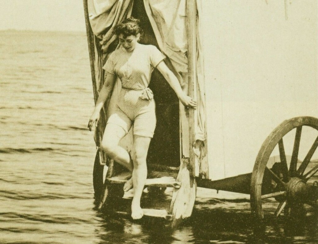 "A woman emerges from a ""bathing machine"" in Germany in 1893. Norwegian bathing doctors took inspiration from trips to the continent and England, where bathing as a medical treatment was considered a high status therapy."